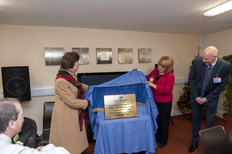 Our Manager Paul and our Chair Jackie assisting HRH The Princess Royal in unveiling a commemorative plaque during her visit to us in 2012.