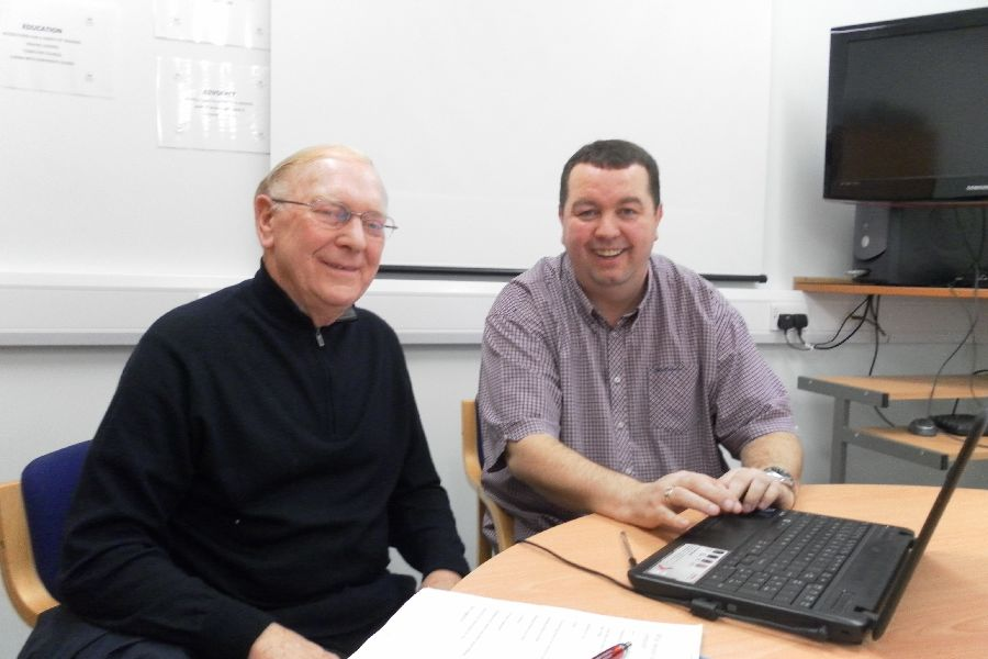Ian teaching Martin some IT tricks at Carers Rights Day